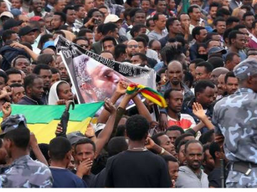 Public Demand Justice as Gathered For Simegnew's State Funeral